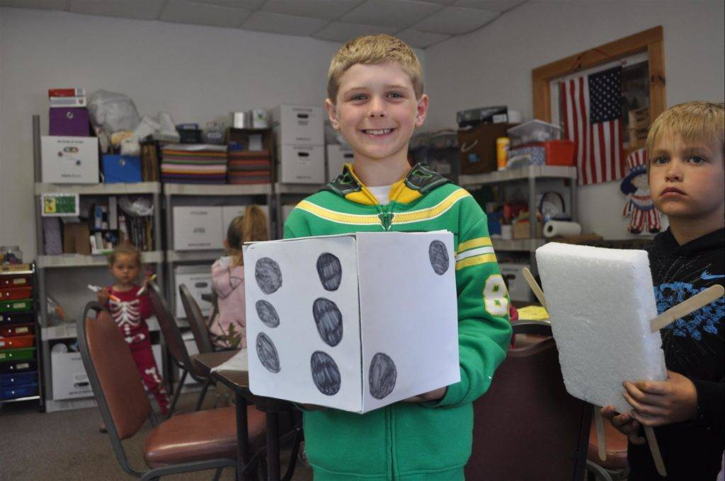 Craft Room Boy with Paper Dice Cube