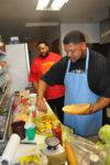 Kyle-and-Gilbert-brown-preparing-the-gilbert-brown-burger-