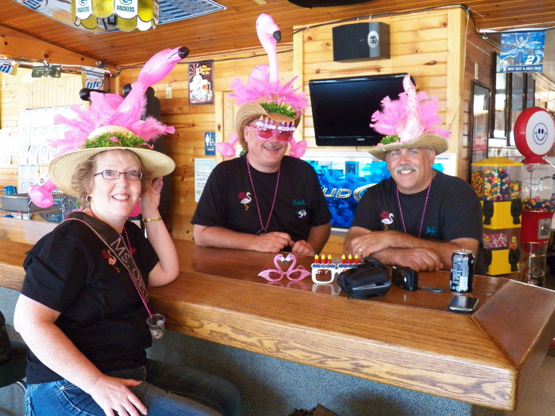 2012-09-15-three-bar-patrons-wearing-pink-flamingo-hats