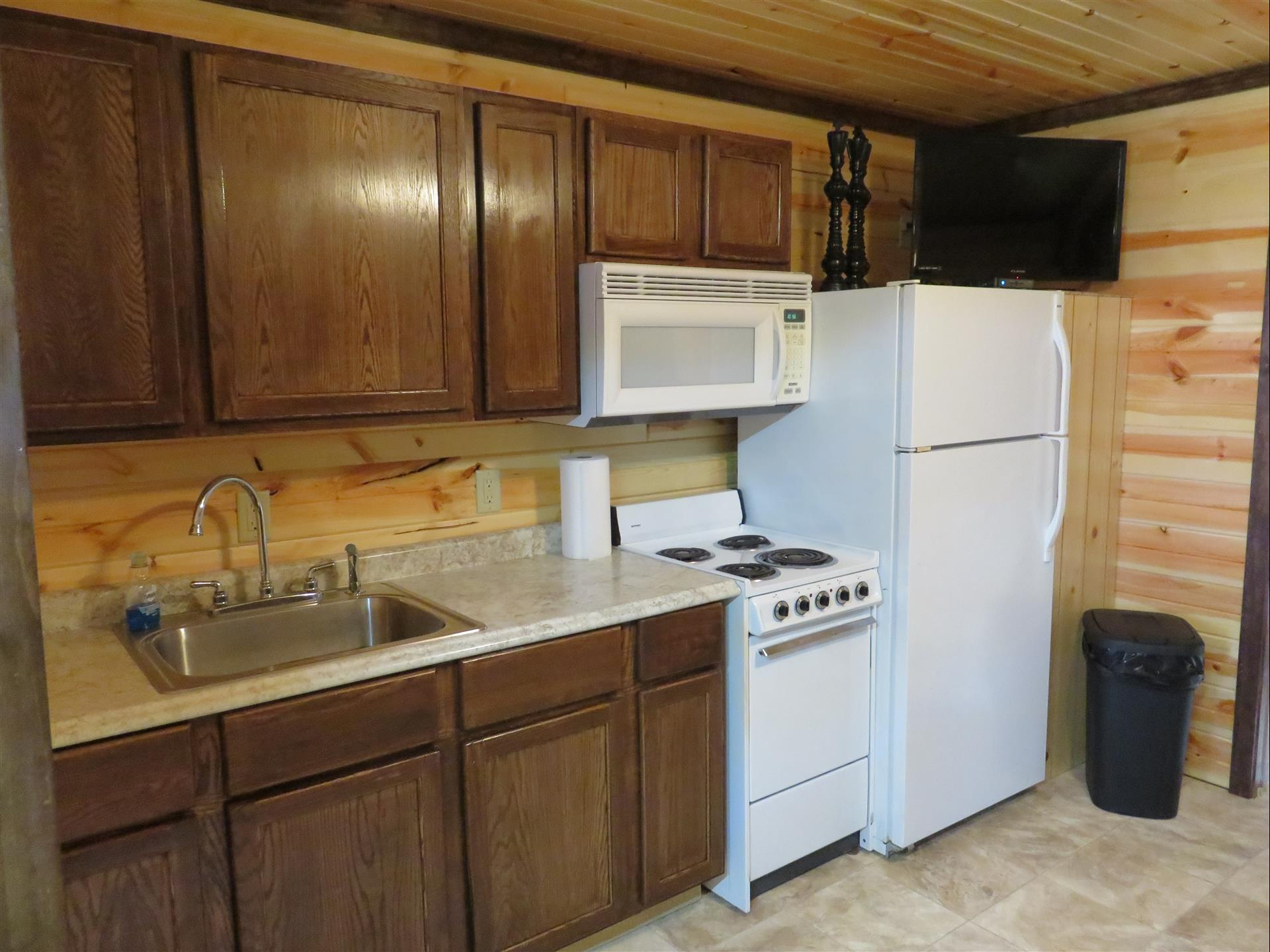 2016-11-16-cabin-interior-kitchen-appliances-cabinets-sink-and ...