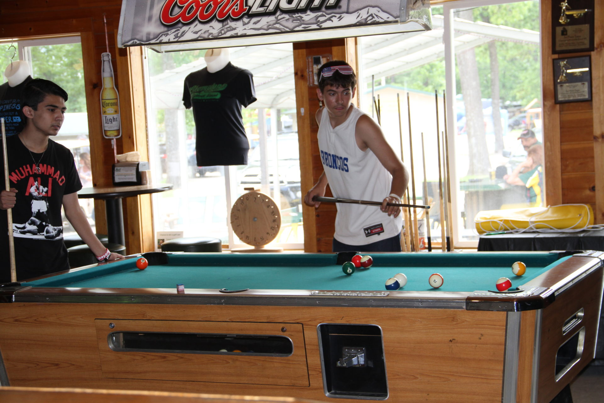 2016-05-30 Two Young Men Playing Pool Inside of Champions